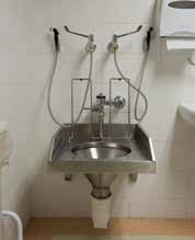 Slop hopper with Walcro 104T flush valve with isolator. The two hands sprays are optional. (FR-CH + WC-104T)