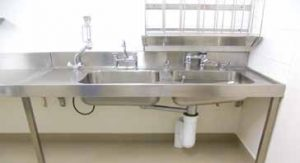 Sluice sink combo with right hand bowls and flush valve. Above right is the bedpan bottle rack BR6.